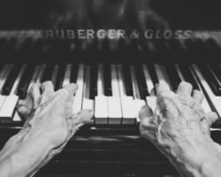 Hands older  on piano